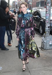 Zoey Deutch paired her chic frock with black T-strap sandals by Jimmy Choo.