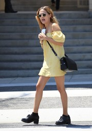 Zoey Deutch paired a black leather shoulder bag with a cute yellow mini for a visit to the nail salon.