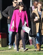 Zooey Deschanel stayed true to her quirky fashion taste and opted for a hot pink cape on the set of 'New Girl.'