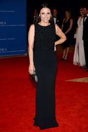 Julia Louis-Dreyfus went for a low-key red carpet look in a sleeveless black Antonio Berardi dress with an embellished bodice during the White House Correspondents' Association Dinner.
