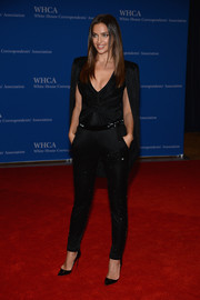 Irina Shayk went from supermodel to superhero in this caped black Atelier Versace jumpsuit when she attended the White House Correspondents' Association Dinner.