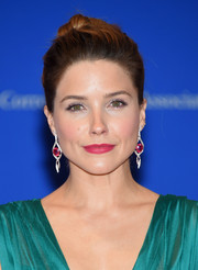 Sophia Bush accessorized with a pair of dangling ruby and diamond earrings that provided a lovely color contrast to her emerald-green dress.