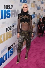 Gwen Stefani teamed her sexy top with tough-looking camo pants.