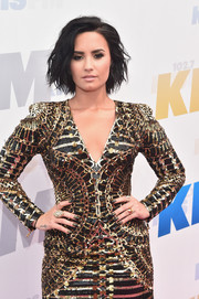 Demi Lovato matched her sequined dress with black and gold nail art when she attended 102.7 KIIS FM's Wango Tango 2016.