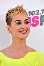 Katy Perry made her eyes pop with a swipe of silver shadow.