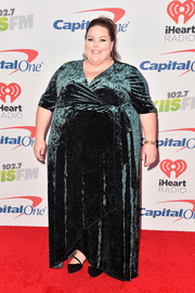 Chrissy Metz went for a classic green velvet wrap gown by Kiyonna when she attended 102.7 KIIS FM's Jingle Ball 2017.