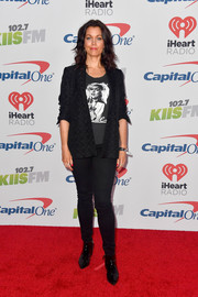 Bellamy Young channeled her inner rock star in a patterned blazer layered over a graphic tee for 102.7 KIIS FM's Jingle Ball 2017.
