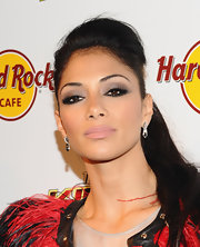 Nicole Scherzinger looked every bit like a rock star princess. She donned a funky feathered ensemble paired with a dramatic smoky eye.