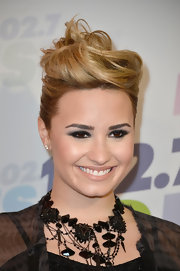 Demi's nude lip added a soft touch to her rocker chick beauty look at Wango Tango.