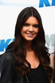Kendall Jenner wore her long hair in soft waves while attending a KIIS FM event.
