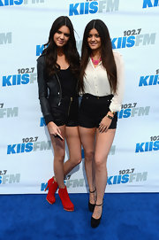 Kendall Jenner arrived at KIIS FM's Wango Tango event wearing bold red suede boots.