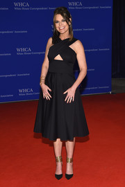 Black pumps with gold ankle cuffs completed Savannah Guthrie's look.