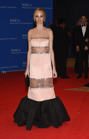 Lauren Santo Domingo looked festive at the White House Correspondents' Association Dinner in a pink and black mermaid gown with sheer inserts and fringe detailing.