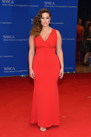 Ashley Graham put her curves on show in a low-cut, body-con red gown during the White House Correspondents' Association Dinner.
