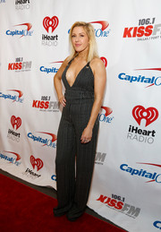 Ellie Goulding put on a seriously sexy display in a plunging monochrome jumpsuit during KISS FM's Jingle Ball.
