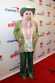 Kesha went cowgirl-chic in an embroidered green blazer and a matching hat at 106.1 KISS FM's Jingle Ball 2017.