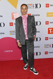 Adwoa Aboah teamed a gray suit with a pink shirt for the 10th Anniversary Women in the World Summit.