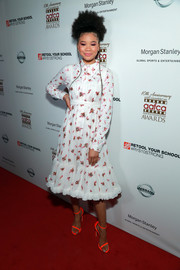 Storm Reid kept it cute and youthful in a beaded ruffle-hem dress by Mulberry at the AAFCA Awards.