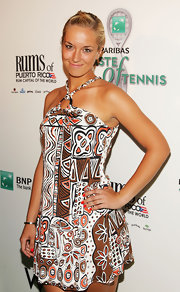 Sabine Lisicki's red nail polish popped against her printed dress.