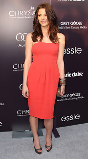 Ashley Greene added shine to her sophisticated coral dress with pewter platform peep-toes.