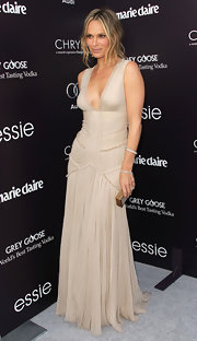 Molly Sims gave her romantic gown a glam finish with a gold python and Swarovski Jean clutch.