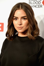 Olivia Culpo attended the Delete Blood Cancer Gala wearing face-framing shoulder-length waves.