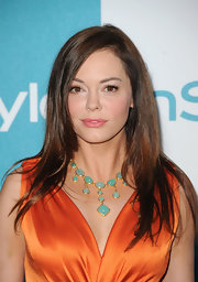 Rose McGowan accented her stunning orange  dress at the 'InStyle' Summer Soiree with a glamorous gold and aqua Chalcedony necklace.