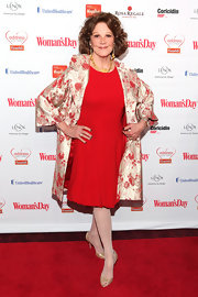 Linda Lavin added some floral fun to her red dress with a floral brocade evening coat.