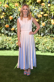 Anna Camp kept it breezy in a white and blue maxi dress with sheer stripes at the 2019 Veuve Clicquot Polo Classic Los Angeles.