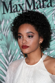 For her beauty look, Kiersey Clemons paired a sexy red lip with gray eyeshadow.