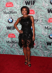 Gabrielle Union looked sultry in a sheer-bottom LBD by Rodarte at the Women in Film pre-Oscar cocktail party.