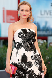 Diane Kruger's fuchsia Rauwolf clutch provided just the right pop of color to her monochrome dress at the Venice Film Fest premiere of '11 Minutes.'