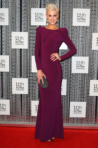 Kate went for the a sleek futuristic look with this long-sleeve grape-hued gown that featured raised shoulder pads.