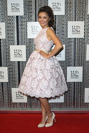 Naomi Sequeira's lace A-line dress had touches of classical romance on the red carpet.