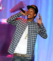 Wiz Khalifa wore a button-down plaid shirt for his performance at the BMI Urban Awards.