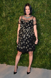 Eva Chen showed off her festive maternity style with this embellished sheer-overlay dress at the CFDA/Vogue Fashion Fund Awards.