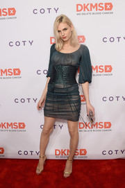 Andreja Pejic styled her sexy frock with elegant gold heels.