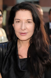 From her long straight hairstyle to her barely-there makeup, Marina Abramovic kept her look natural.
