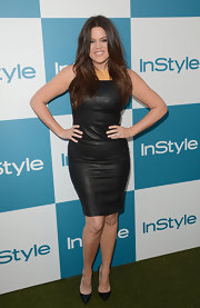 Leave it to a Kardashian to show up at a summer party wearing ALL leather. Khloe took to the grassy carpet in this fierce LBD and pointy Louboutin pumps.