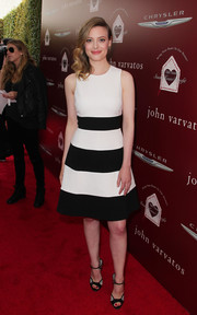 Gillian Jacobs continued the monochrome motif with a pair of black and gray ankle-strap sandals.