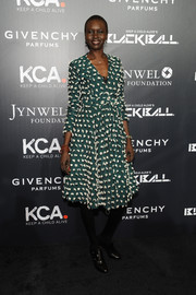 Alek Wek went for classic chic in an appliqued green and white wrap dress during the Keep a Child Alive Black Ball.