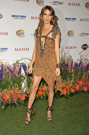 Dawn played the part of the native girl in a tribal-inspired ensemble and fur-embellished, brown strappy sandals.