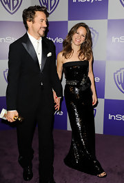 Susan Downey shimmered in a sequined black strapless dress with an embellished belt at the Golden Globes after-party.