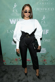 Kat Graham attended the Women in Film pre-Oscar party wearing a white George Keburia blouse with Juliet sleeves.