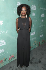 Viola Davis chose a black BCBG Max Azria gown with a cleavage-baring panel, waist cutouts, and ruffle detailing for the Women in Film pre-Oscar party.