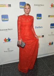 Nicky Hilton looked demure yet oh-so-elegant in a red lace evening dress by Valentino during the Brazil Foundation NYC Gala.