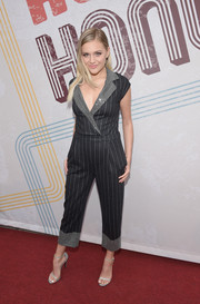 Kelsea Ballerini looked oh-so-cool in a charcoal Emporio Armani jumpsuit with a contrast hem and lapels at the 2018 ACM Honors.
