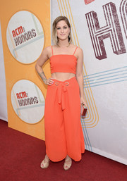 Cassadee Pope matched her top with orange wide-leg pants.