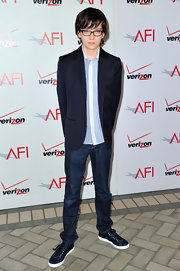 Asa added some class to his outfit with a navy pinstripe blazer.