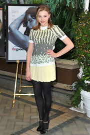 Chloe topped off her winter style with black tights and cap-toe pumps.